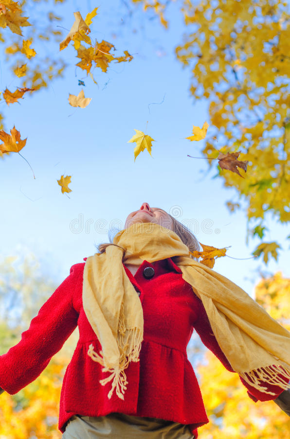 Download Happy Woman Throwing Leaves. Stock Image - Image: 34431981