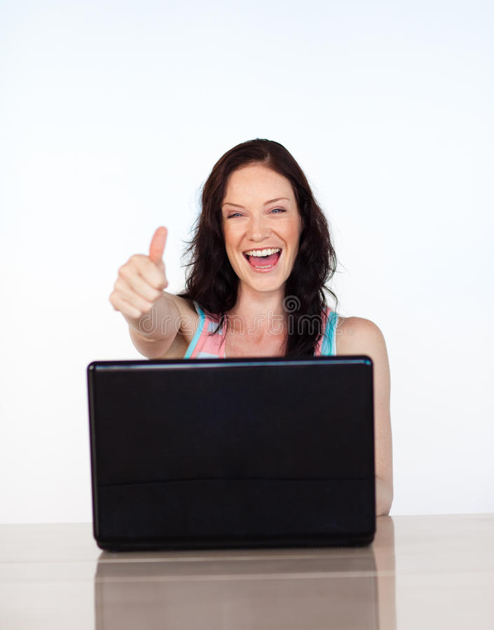 Download Happy Woman With Thumbs Up Using Her Laptop Stock Photo - Image: 9888212