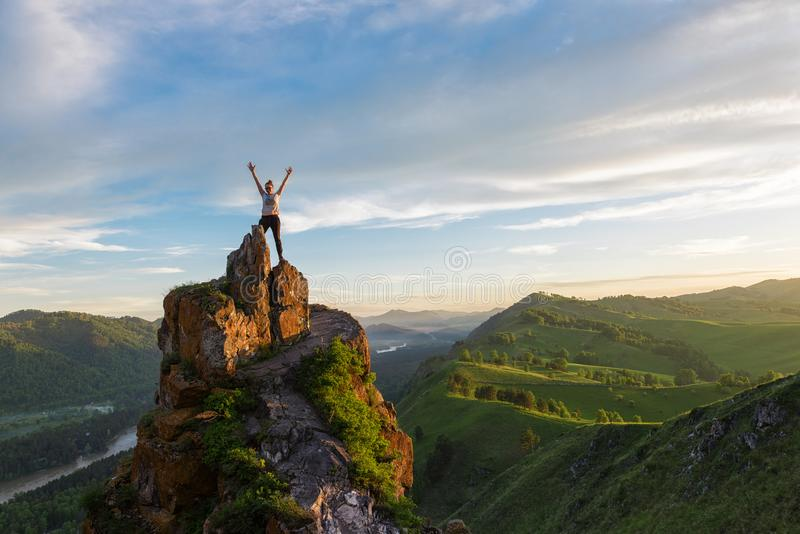 Happy woman on top mountain stock images