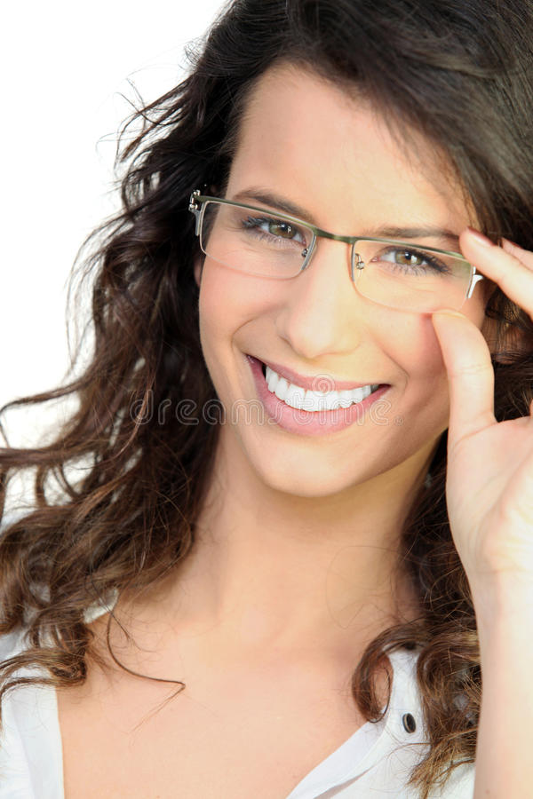 Happy woman touching glasses stock image