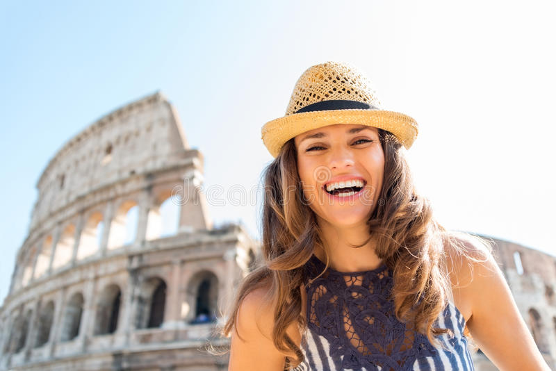 Happy woman tourist in Rome near Colosseum in summer. On a sunny summers day, a smiling female tourist stands near the Colosseum in Rome stock images