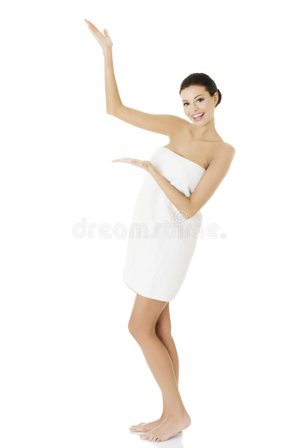 Happy woman in towel showing copy space royalty free stock images