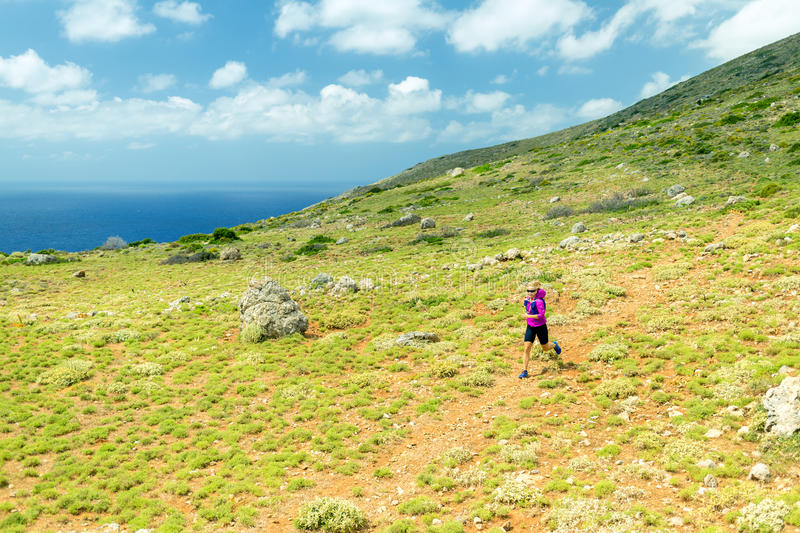 Happy woman trail running in beautiful mountains stock images