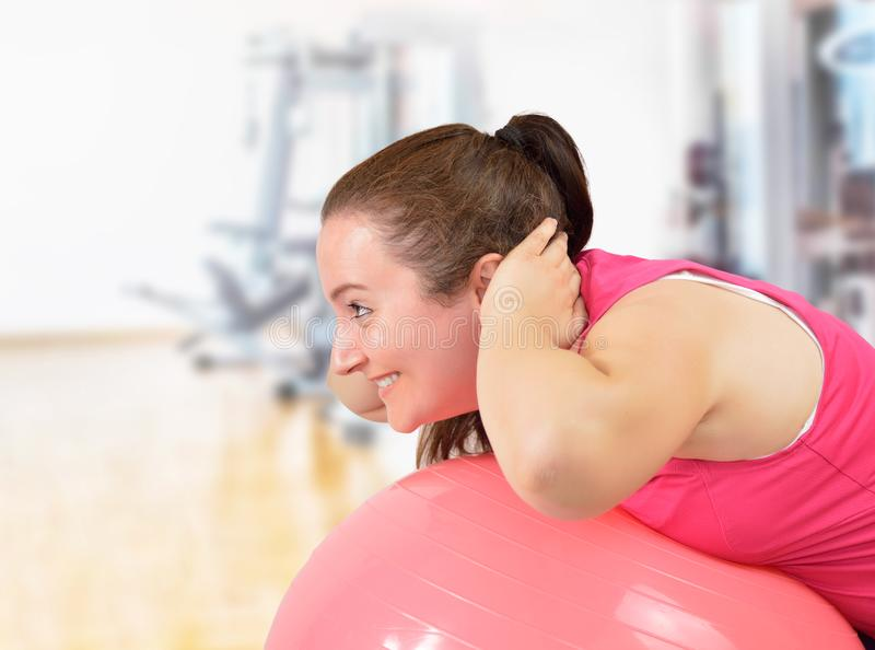 Happy woman training with fitness ball stock images