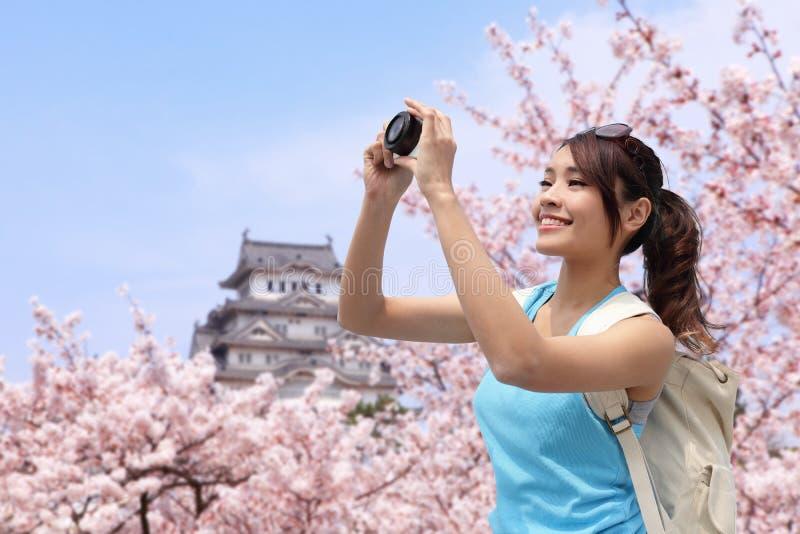 Happy woman traveler take a photo stock photos