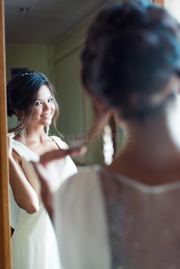 Happy woman trying on new dress in showroom. Fashion and choice concept stock images