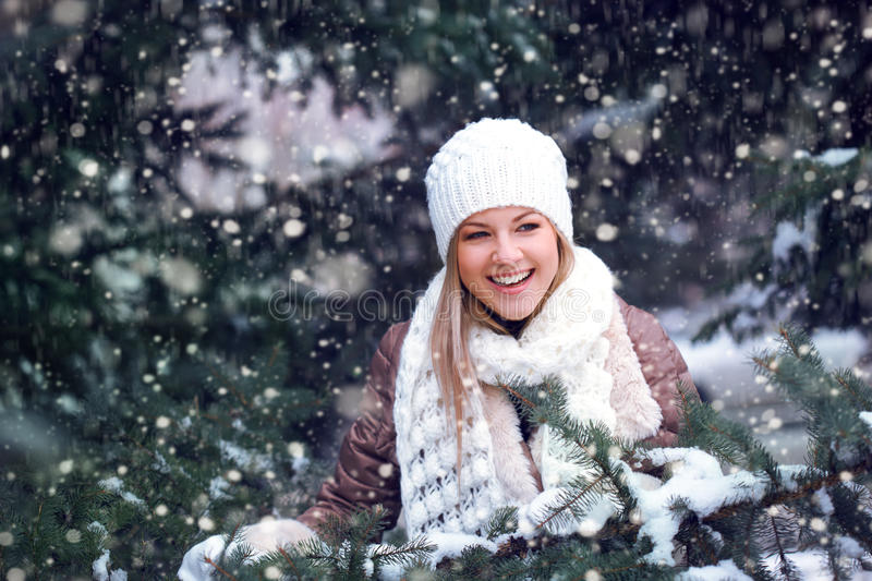 Happy woman under snowfall royalty free stock image