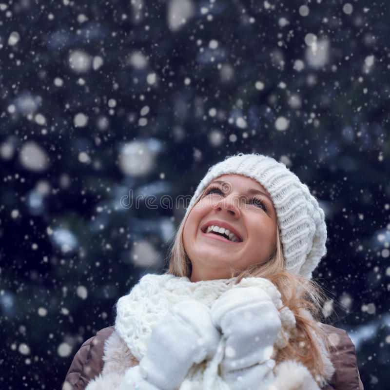 Happy woman under snowfall stock images