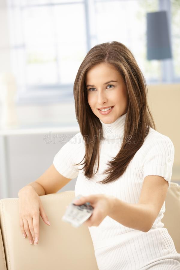 Download Happy Woman Using Remote Control Royalty Free Stock Photography - Image: 18760367