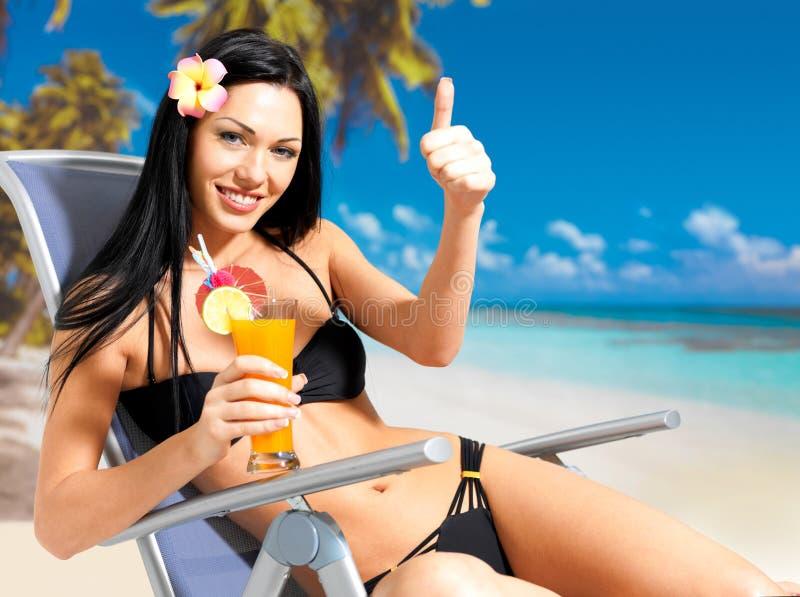 Happy woman on vacation enjoying at beach