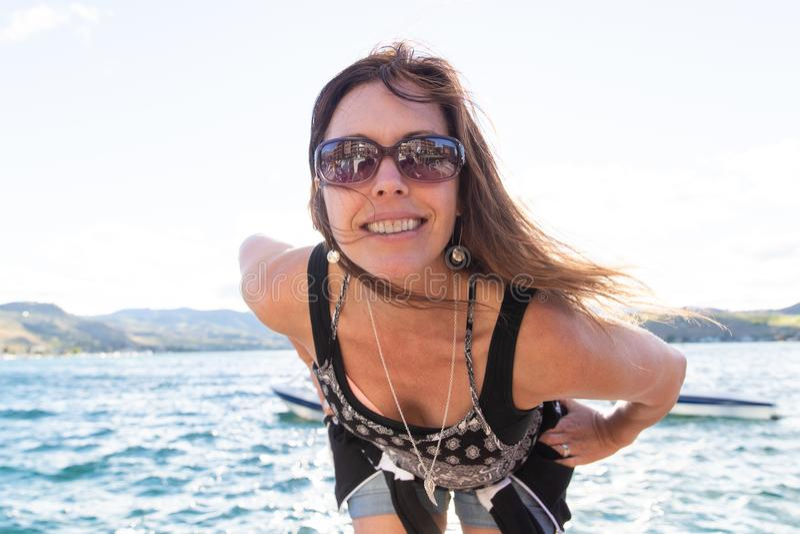 Happy woman on vacation at a lake stock photo