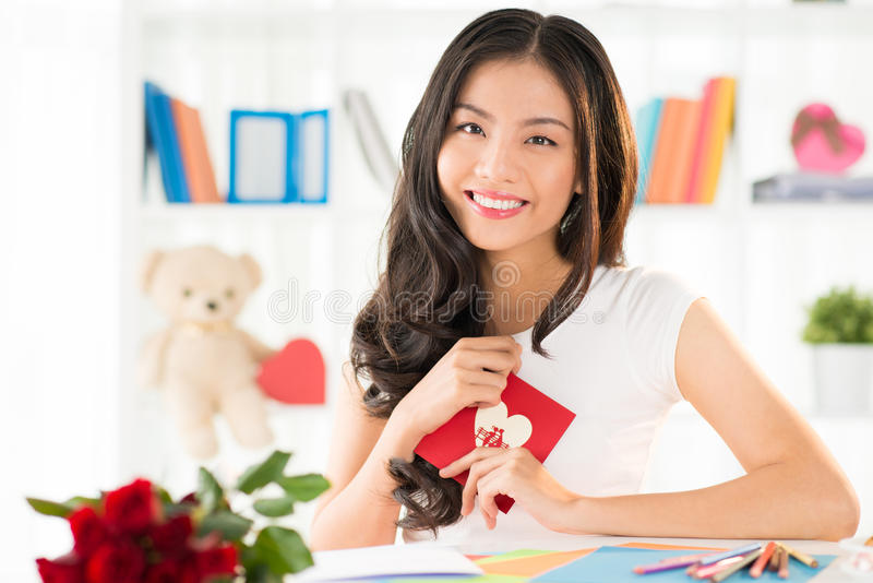 Happy woman with Valentines greeting card stock photo