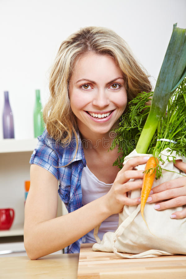 Happy woman with vegetables stock photography