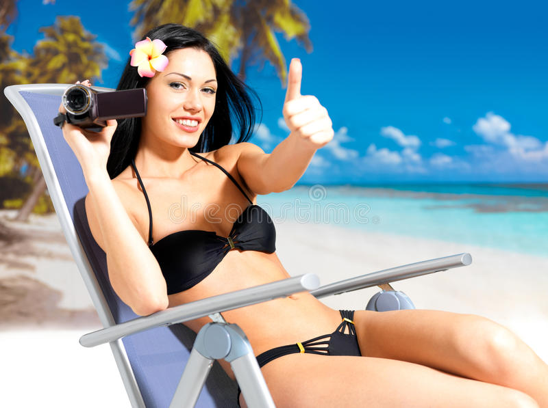 Happy Woman With A Video Camera On Beach Royalty Free Stock Image