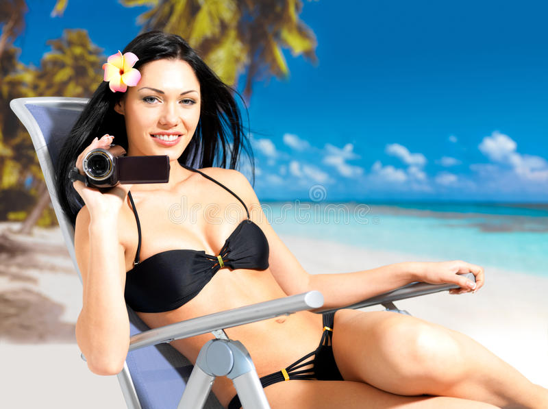 Download Happy Woman With A Video Camera On Beach Royalty Free Stock Photo - Image: 28773865