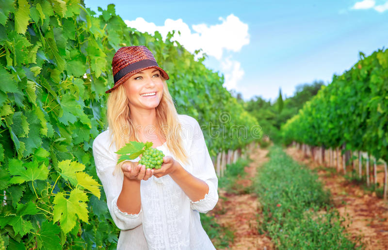 Happy woman on the vineyard stock image