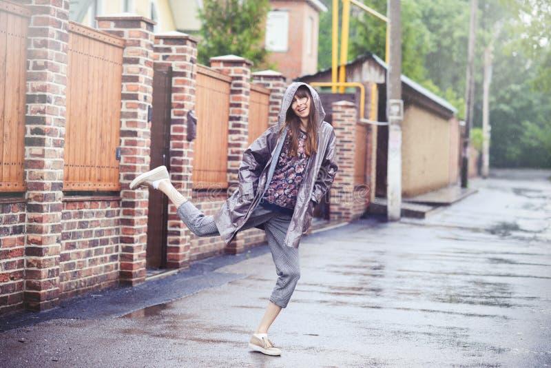 Happy woman walking in the rain royalty free stock photo