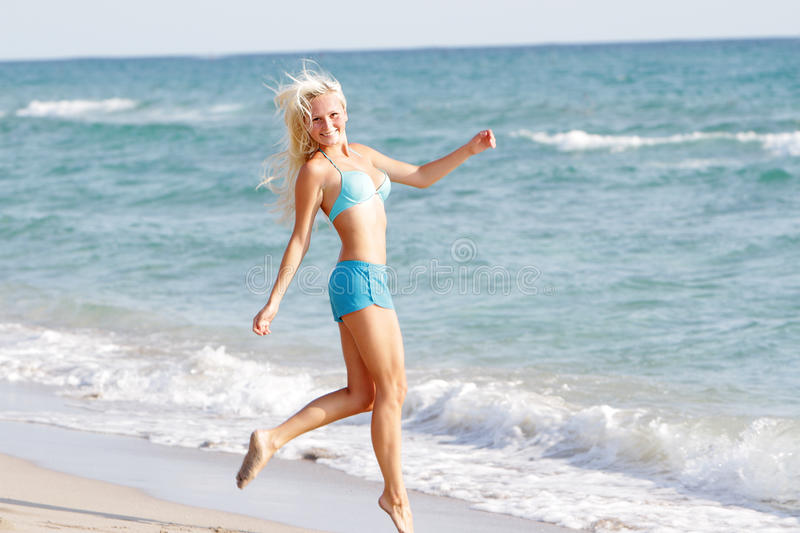 Download Happy Woman Walking By Sand Beach Stock Photo - Image of happy, carefree: 26649096
