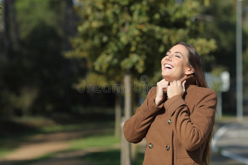 Happy woman warmly clothed in winter breathing fresh air royalty free stock photo