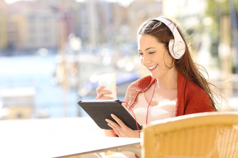 Happy woman watching streaming media content stock image