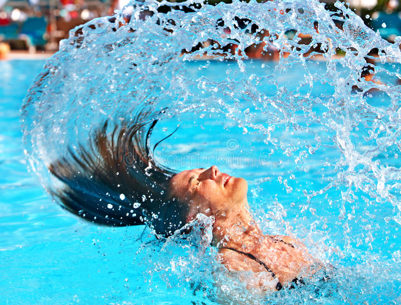 Happy woman in water waving hair stock photography