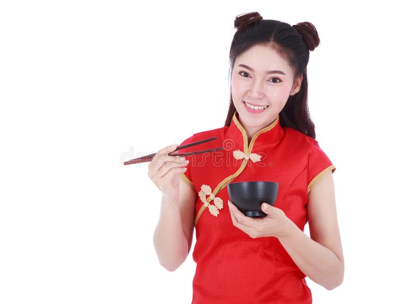 Woman wearing chinese cheongsam dress with chopsticks and bowl i royalty free stock image