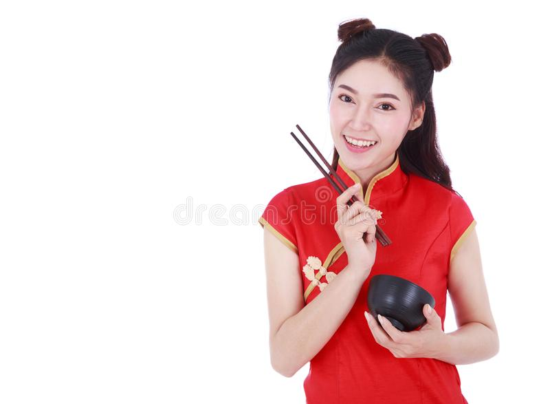 Woman wearing chinese cheongsam dress with chopsticks and bowl i royalty free stock photography
