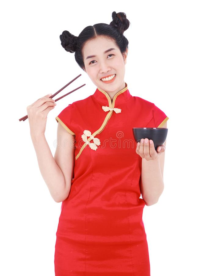 Happy woman wearing chinese cheongsam dress with chopsticks and stock images