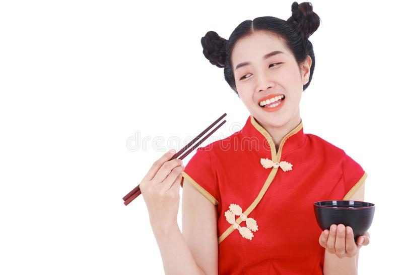 Happy woman wearing chinese cheongsam dress with chopsticks and royalty free stock image