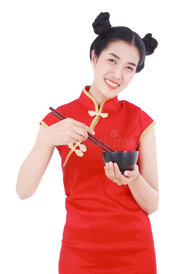 Happy woman wearing chinese cheongsam dress with chopsticks and royalty free stock photography