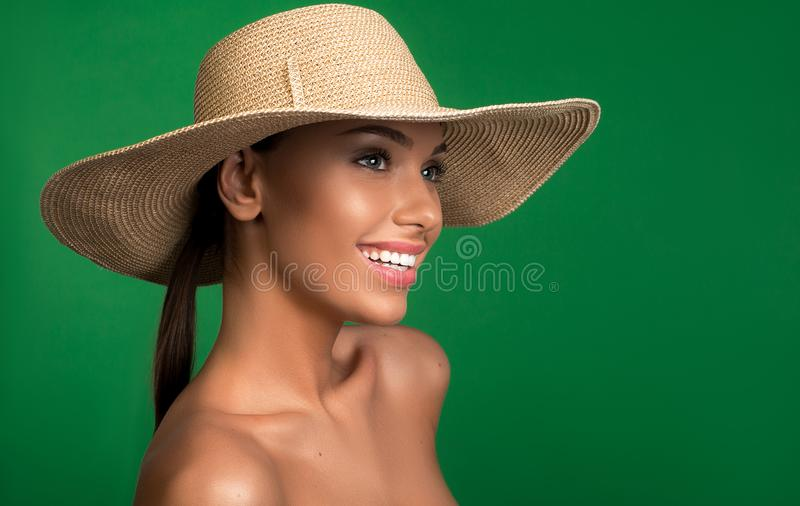 Happy woman wearing hat on head. Nice looking girl with headwear looking aside with smile. Copy space in right side. Isolated on background stock images