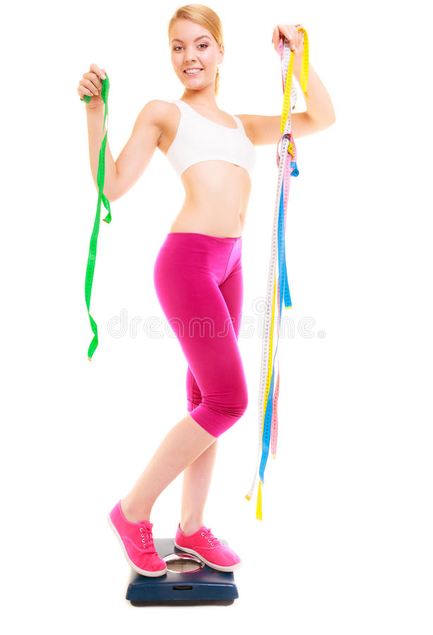 Happy woman on weighing scale. Dieting slimming. royalty free stock photography