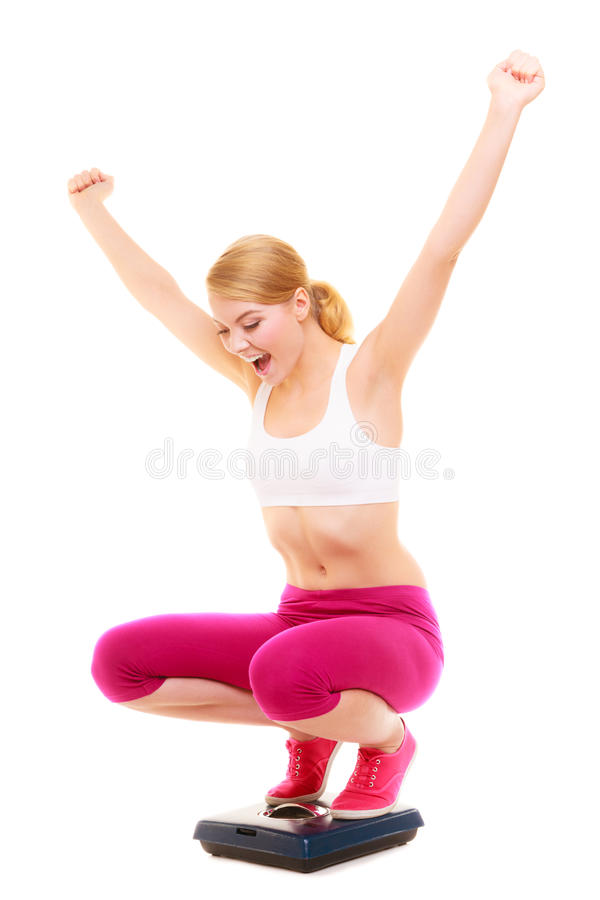 Happy woman weighing scale. Slimming weight loss. Slimming diet weight loss success. Happy joyful young woman girl on weighing scale raising her arms hands stock images