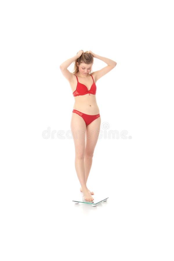 Happy Woman On Weight Scale Royalty Free Stock Image