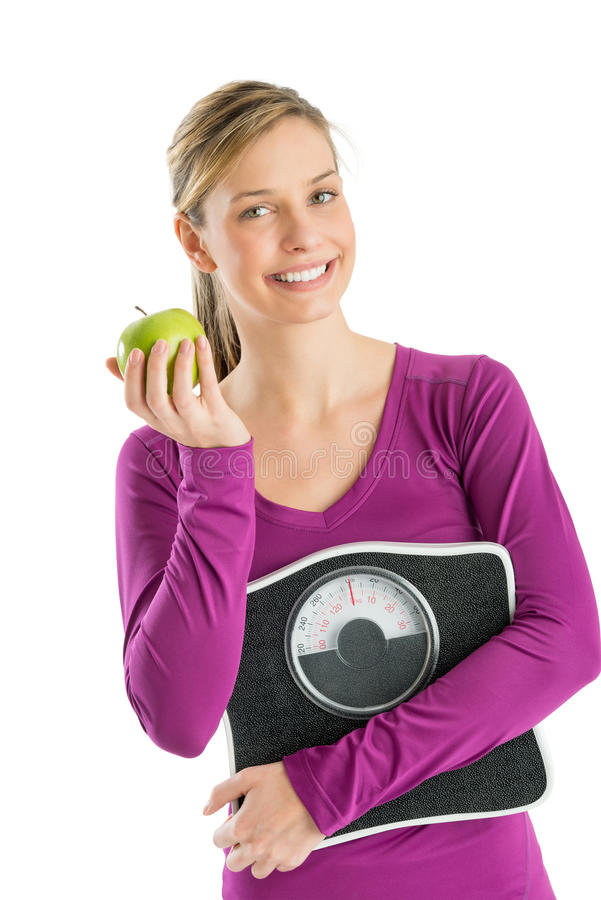 Happy Woman With Weight Scale And Smith Apple Stock Photography