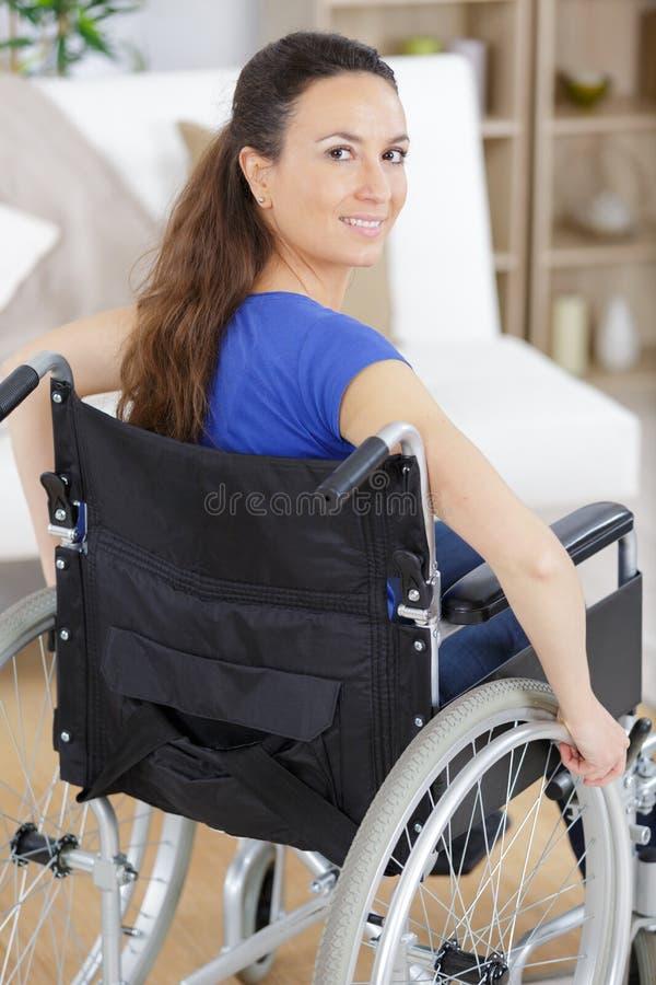 Happy woman in wheelchair stock photos