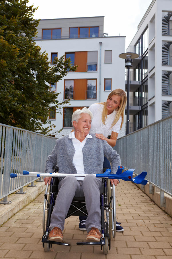 Download Happy Woman In Wheelchair On A Ramp Stock Image - Image of geriatric, nursing: 17020397