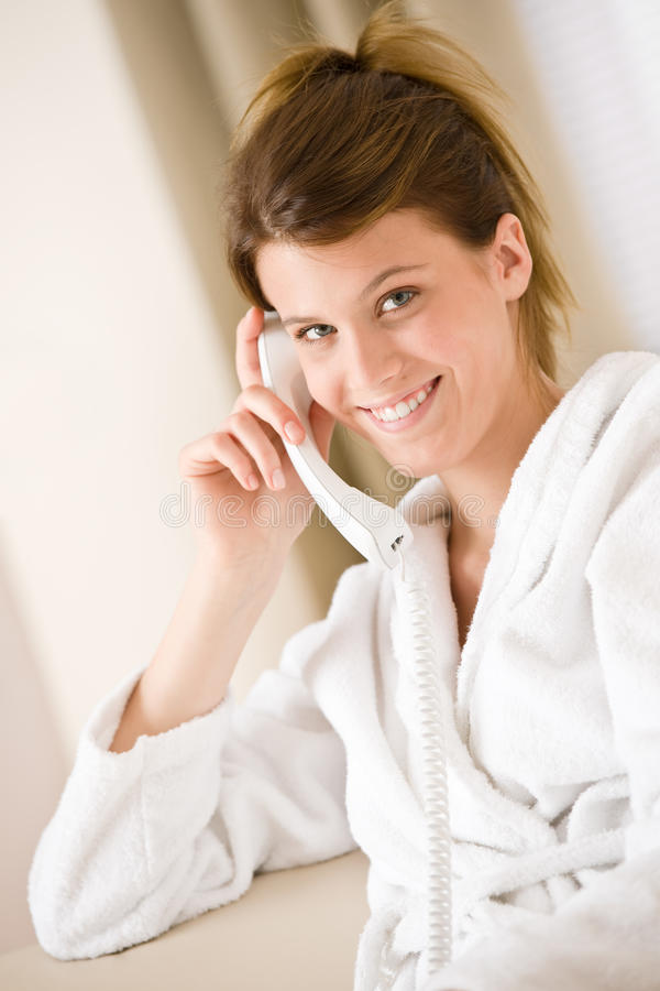 Download Happy Woman In White Bathrobe With Phone Stock Photo - Image: 14529322
