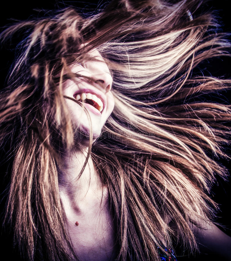 Happy woman with wind blown hair stock photos