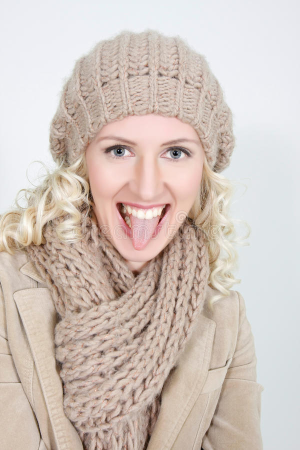happy woman in winter clothes stock photography