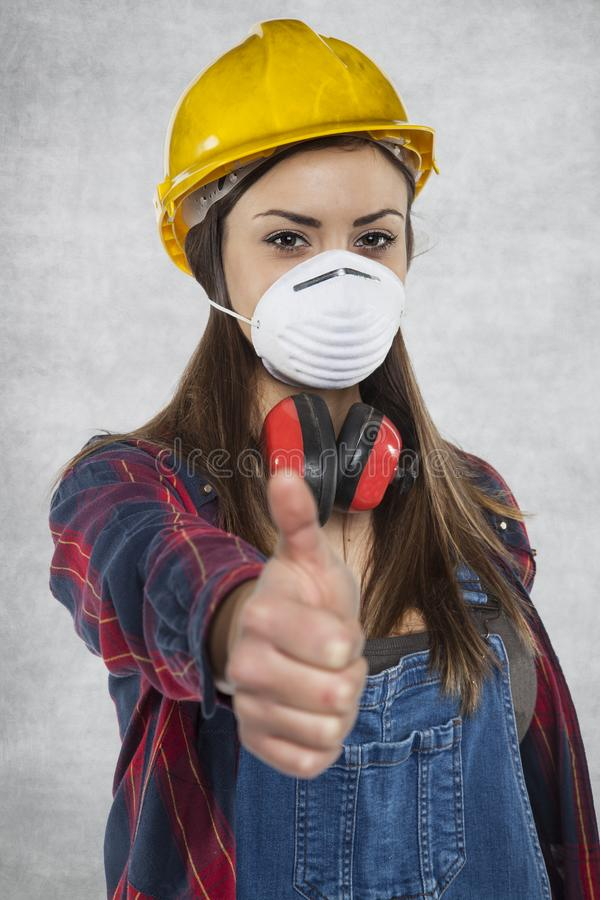 Happy woman worker, thumb up stock photography