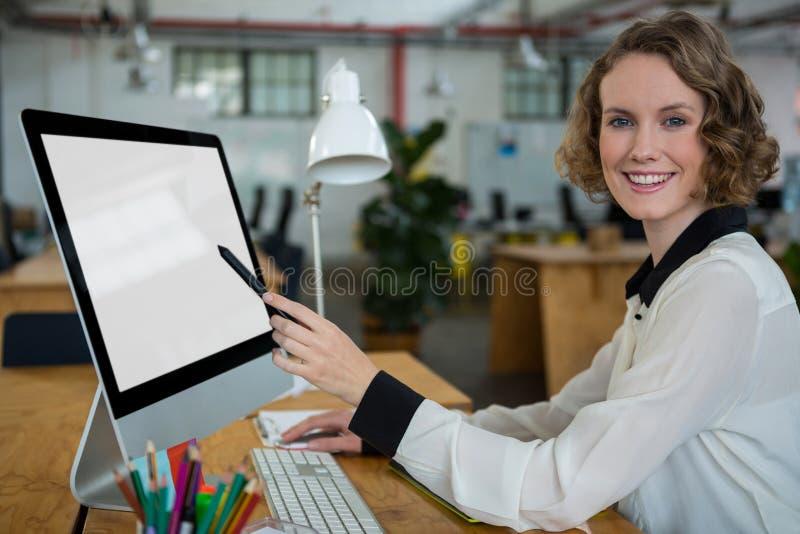 Happy woman working on desktop pc stock photo