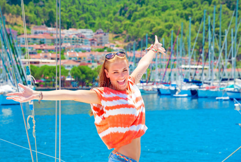 Happy woman at yacht port royalty free stock photos