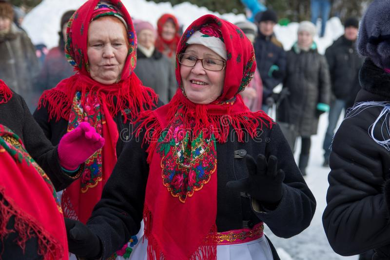 Happy womans plays during Shrovetide stock images
