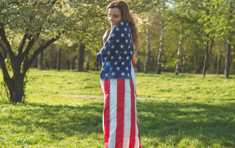 Happy women with American flag USA celebrate 4th of July. Happy woman with American flag USA celebrate 4th of July royalty free stock photography