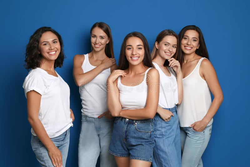 Happy women on blue background royalty free stock image