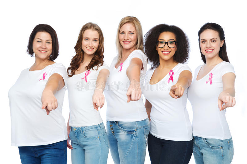 Happy women with breast cancer awareness ribbons. Diverse, healthcare and people concept - group of happy different size women in white t-shirts with pink breast stock photo