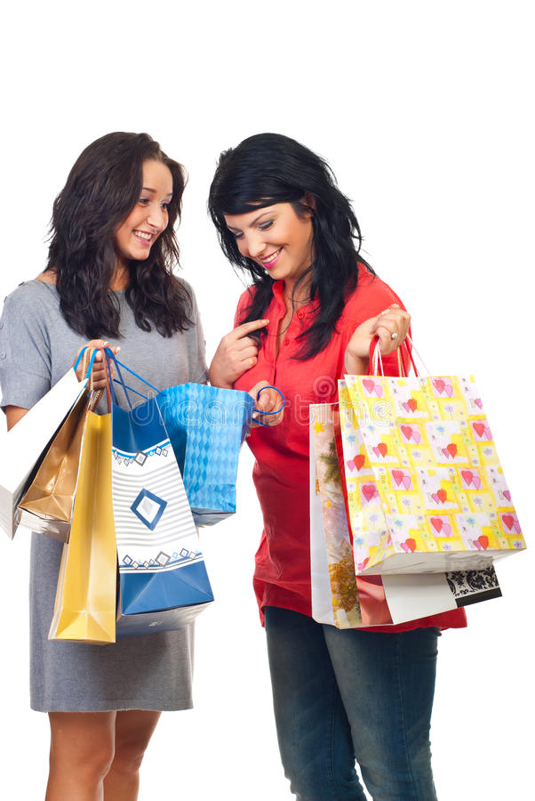 Happy women conversation at shopping stock images