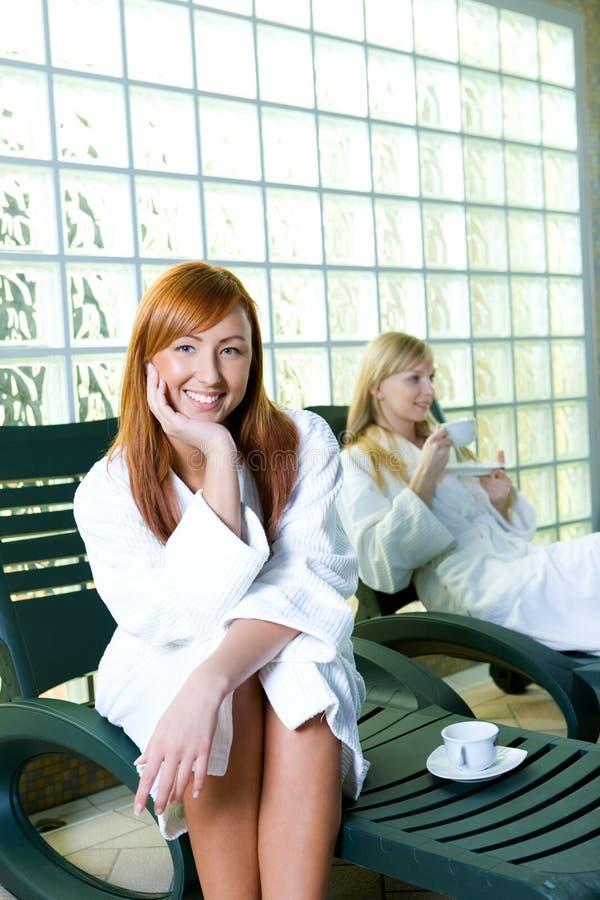 Happy women on deckchair stock photography