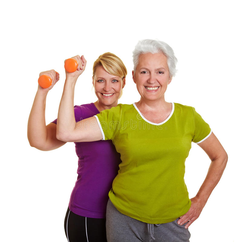 Happy women exercising stock images